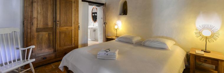 Slaapkamer met open haard Casa Cuco